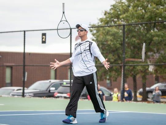 Yorktown's Ian Landwehr tosses his racket in the air