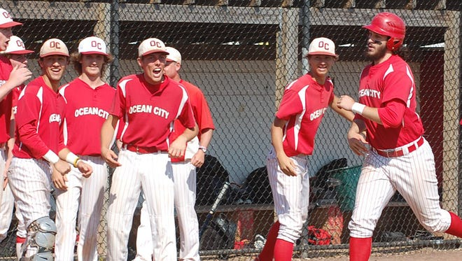 Nick Artymowicz of Ocean City makes his way to home plate after hitting a two-run home run in the first inning of Wednesday's sectional semifinal against Mainland.