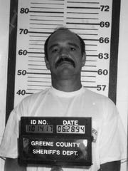 A 1994 booking photo of Kenneth Allen