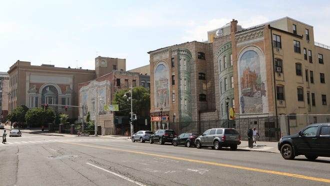 The Gateway to the Waterfront murals by Richard Haas are seen on 5 Riverdale Ave., far left, the side of 36 Main St., middle left and 35 Main St., in Yonkers.