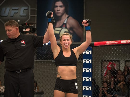 Amanda Bobby Cooper celebrates her submission victory over Mellony Geugjes during The Ultimate Fighter elimination fights at the UFC TUF Gym on January 26, 2016 in Las Vegas.