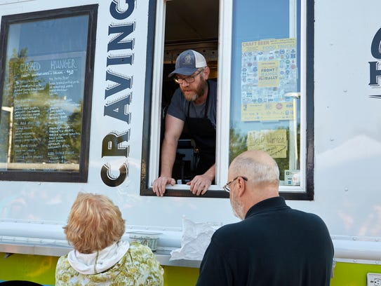 Festival goers ask questions at the Curbed Hunger food
