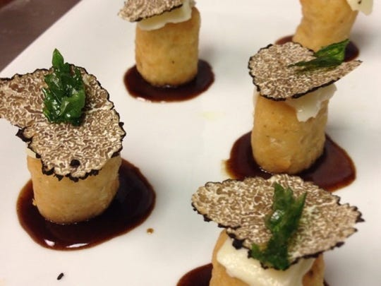 Disco tots with truffle and Demi glace at Village Green restaurant in Ridgewood