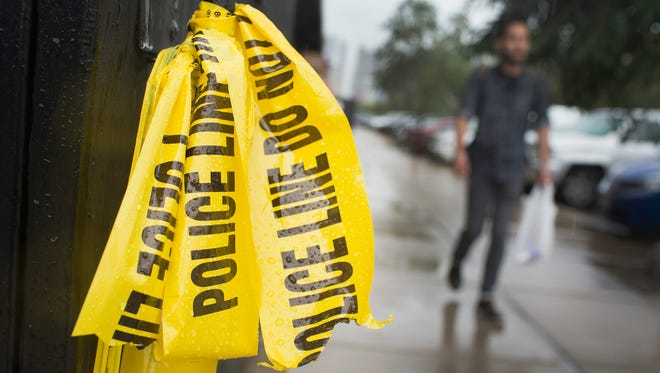 Crime scene tape hangs in the West Loop restaurant district where a 23-year-old man was shot and killed over the Labor Day weekend in Chicago.