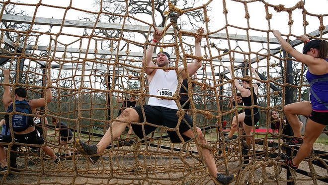 Competitors participate in the Warrior Dash on March 22, 2014, in Smithville, Texas. Warrior Dash began in 2009 and has drawn 2.5 million participants.
