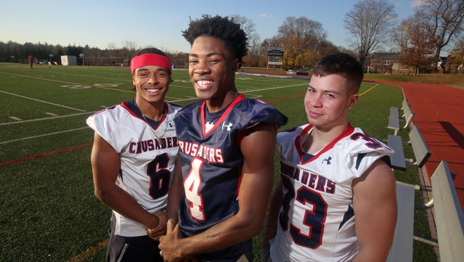 Stepinac High School football players T.J. Morrison, left, Tyquell Fields, and Daniel Negron will lead the Crusaders as they play St. Francis in the second annual CHSAA state championship, Saturday at Grand Island High School. The Crusaders lost in the same game last year.
