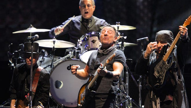 "Shown during ""Wrecking Ball"" at MetLife Stadium in East Rutherford, NJ, Tuesday, August 23, 2016, are (l-r): Nils Lofgren, Bruce Springsteen and Steven Van Zandt.  In the background is Max Weinberg."