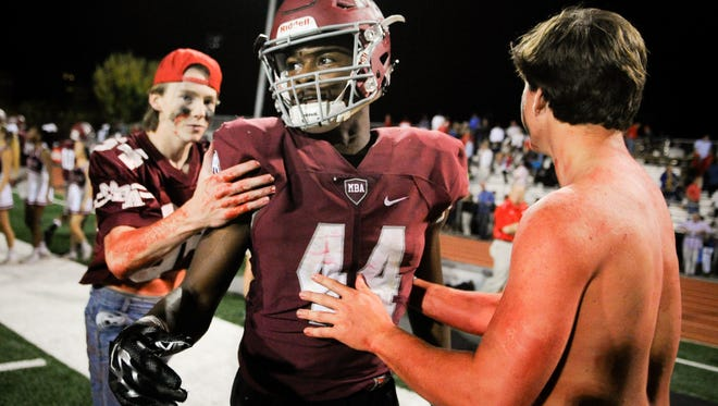 Montgomery Bell Academy's Tykevius Chandler (44) celebrates with fans after defeating Brentwood Academy in a football game at Montgomery Bell Academy, Friday, Oct. 7, 2016, in Nashville, Tenn.