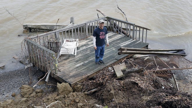 Rick Davis of Hamlin, N.Y., stands on a deck May 2, 2017, that was destroyed because of Lake Ontario's high water level.