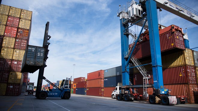 Shipping containers are loaded and unloaded at the South Carolina Inland Port in Greer, which announced an expansion Friday.