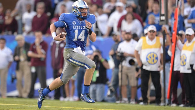 UK QB Patrick Towles runs with the ball during the second half of the University of Kentucky football game against Mississippi State in Lexington, Ky. Saturday, October 25, 2014.