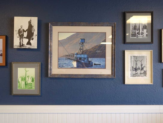 A photo of the F/V CHULA hangs on the wall at Chula