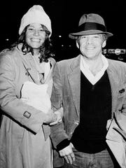 """In this Nov. 28, 1980 file photo, Chuck Barris, host of the television's """"Gong Show,"""" and Robin Altman leave the Pierre Hotel in New York. Game show impresario Barris has died at 87. Barris, the madcap producer of """"The Gong Show"""" and """"The Dating Game,"""" died of natural causes Tuesday afternoon, March 21, 2017, at his home in Palisades, New York."""