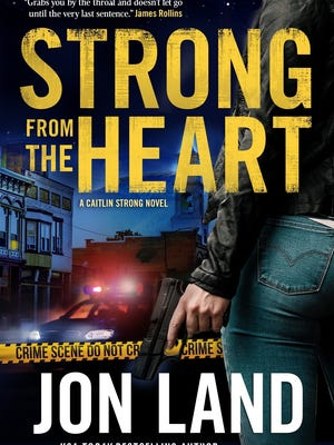 """The cover of """"Strong from the Heart"""" by Jon Land."""