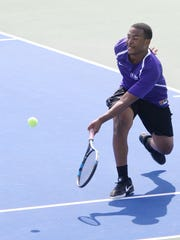 Byrd's Corie Means returns a serve in the LHSAA Division
