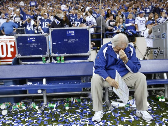 Longtime NFL coach and Colts offensive coordinator Tom Moore sheds a tear by himself on the bench after the confetti fell at the RCA Dome.