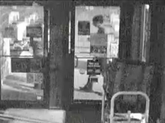 This security camera photo shows a grainy image of