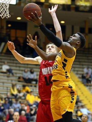 Jan 31, 2015; Hattiesburg, MS, USA; Southern Miss Golden Eagles guard Chip Armelin (13) drives against Western Kentucky Hilltoppers forward Ben Lawson (14) in the second half at Reed Green Coliseum. Western Kentucky won, 73-62. Mandatory Credit: Chuck Cook-USA TODAY Sports