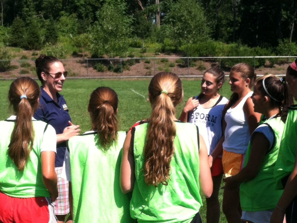 Academy of Saint Elizabeth athletic director and athletic trainer Erin Boccher talks to the girls soccer team after practice in August.