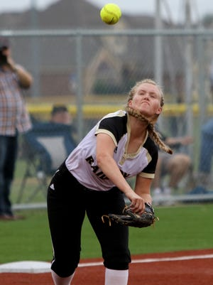 Rider's Bayleigh Holley throws to first for the out in the playoff game against Eaton Friday, April 28, 2017, at Sunrise Optimist fields. The Eaton Eagles defeated the Rider Raiders 19-6.