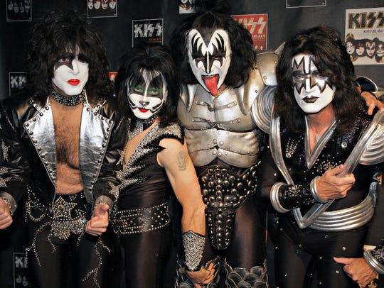 Members of Kiss, from left, Paul Stanley, Eric Singer,