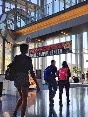 IUPUI students walk through the Campus Center at Indiana University-Purdue University Indianapolis on Sept. 16, 2015.
