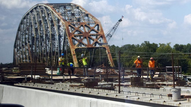Work is continuing on the southbound span of the Curtis-Coleman Memorial Bridge (foreground) as the O.K. Allen Bridge looms in the background. The southbound span is expected to be ready by Jan. 1.