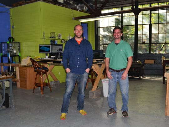 Founders Ryan Gundling and Ryan Long at their workspace