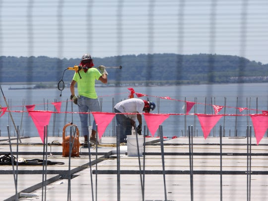 Construction workers work on the Westchester-bound