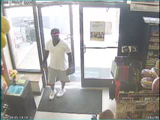 Police are looking for this man in connection with a stolen credit card.