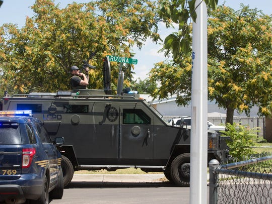 Las Cruces Police Department's SWAT team moves into
