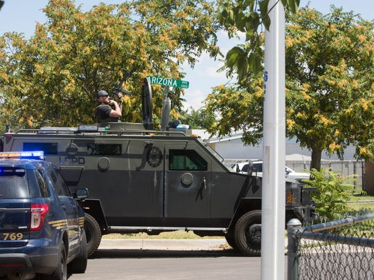 Las Cruces Police Department's SWAT team moves into location on Arizona Avenue after noon on Monday, July 17, 2017. Later in the day, LCPD announced a 52-year-old man had been shot dead during the incident.