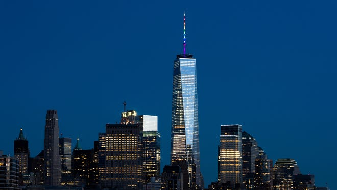 One World Trade Center on Sunday, June 12, is lit in the color of the pride flag to honor victims in Orlando terror attack