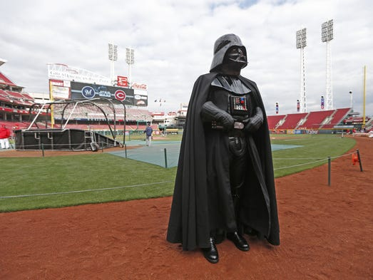 """Darth Vader hangs out on the field prior to Friday's Reds-Brewers game as part of """"Star Wars Night"""" at Great American Ball Park."""