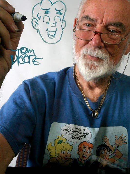 """""""Everything I see is a comic,"""" Tom Moore, a cartoonist for the Archie comic strip, said. Moore has been drawing comics since 1930. photo by Debra Gulbas"""