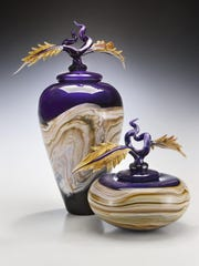 In this undated photo provided by Gartner/Blade, an Amethyst covered jar and bowl from Danielle Blade and Stephen Gartner are shown. In their Strata collection of vases and vessels, tones of warm, earthy color are blown into layers that evoke geological terrain. Some of the design duo's objects come topped with surprising and exquisite touches, like a delicate snail's head; a sliver of animal bone or antler; or a curling leaf.