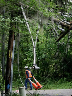Talquin Electric crews begin the process of repairing a damaged electric line on Crowder Road.