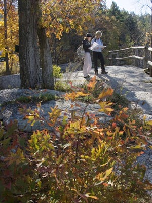 A couple takes advantage of the Hudson Valley's fall foliage while on a walk at Mohonk Mountain House. Come fall the valley comes alive with color and outdoor activities, including hiking and festive Halloween parades and events.