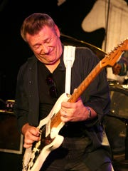 Sonny Kenn is the master of twangy tones and raucous reverb on stage. Behind the easel, he studied at Mercer County Community College, the former Trenton State College and under the tutelage of renowned portrait artist Mel Leipzig.