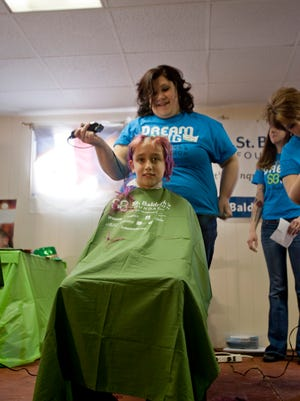 Cole Strong, of Candor, had his hair shaved for the second year in a row Sunday at the St. Baldrick's shave-a-thon.