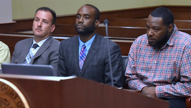 (L-R): Defendant Wynton Dixon sits with his attorney, Daniel Bitar, as attorney Maurice Davis sits with his client, defendant Kyle Jackson, as the judge binds the case over to circiut court.