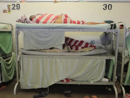 Inmates sleep three to a bunk in Block C in August