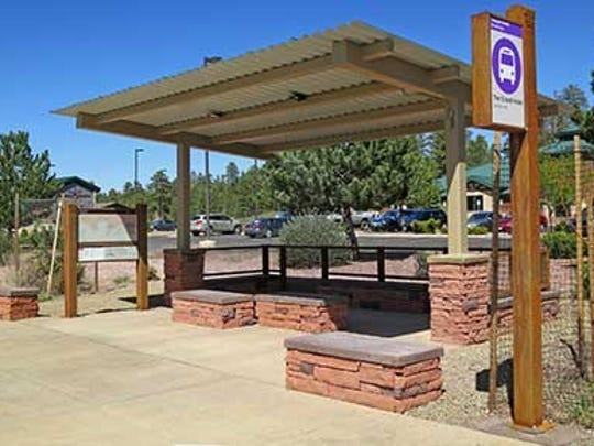Stops for the shuttle bus between Tusayan and the South Rim of the Grand Canyon are marked with purple signs.
