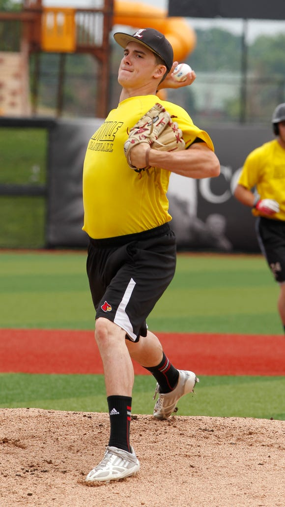 University of Louisville pitcher Nick Burdi (19) pitches during practice as they get ready to play in their Super Regional game at Jim Patterson Stadium in Louisville, Kentucky, June 5, 2014.