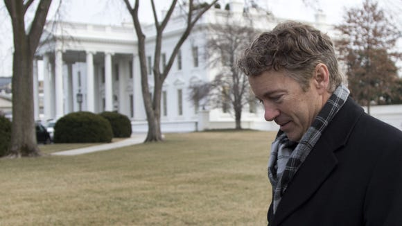 Sen. Rand Paul, R-Ky., walks from the White House after an event hosted by President Barack Obama about the Promise Zones Initiative, Thursday, Jan. 9, 2014, at White House in Washington. The Promise Zone Initiative is part of a plan to create a better bargain for the middle-class by partnering with local communities and businesses to create jobs, increase economic security, expand educational opportunities, increase access to quality, affordable housing and improve public safety. (AP Photo/Carolyn Kaster)