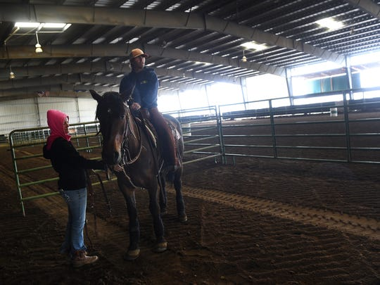 Horse trainers Kirk and Jacky Ferris work with Judd during a rainy afternoon at the Washoe Valley Ranch facility south of Reno on May 17, 2016.