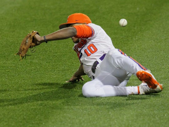 Clemson redshirt sophomore outfielder K.J. Bryant (10) misplays a fly ball hit by South Carolina junior Madison Stokes during the top of the sixth inning on Friday at Doug Kingsmore Stadium in Clemson. The only two runs of the game scored on the play.