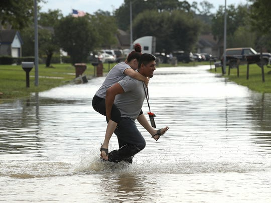Residents begin to return to their homes in north Houston as flood waters began to recede following Hurricane Harvey n Houston, Aug. 30, 2017.