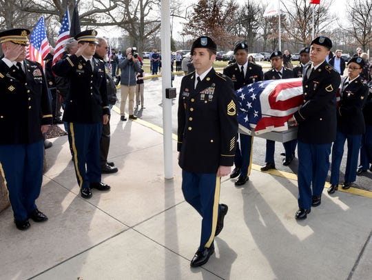 An Army Honor Guard from Ft. Meade, Maryland carry
