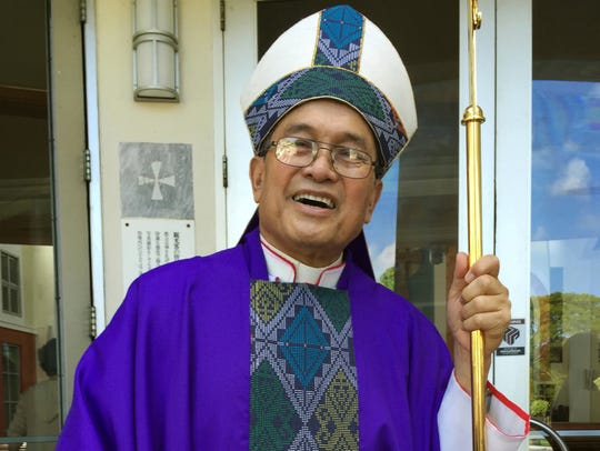 In this Nov. 2014 file photo, Archbishop Anthony Apuron